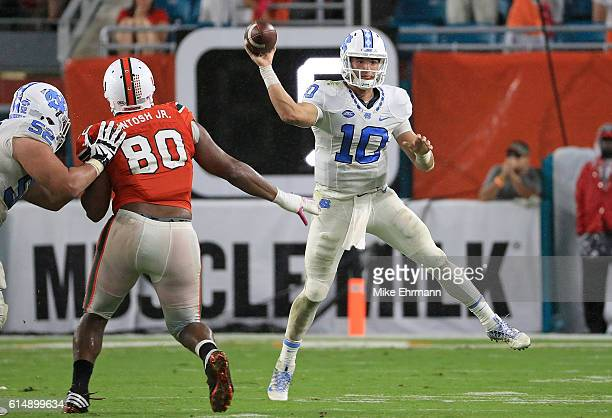 Mitch Trubisky of the North Carolina Tar Heels passes during a game against the Miami Hurricanes at Hard Rock Stadium on October 15 2016 in Miami...