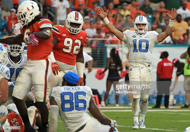 Mitch Trubisky of the North Carolina Tar Heels reacts to a touchdown during a game against the Miami Hurricanes at Hard Rock Stadium on October 15...