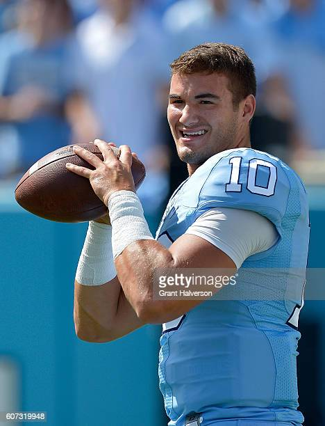 Mitch Trubisky of the North Carolina Tar Heels warms up before the game against the James Madison Dukes at Kenan Stadium on September 17 2016 in...
