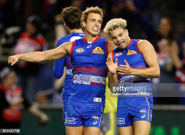 Mitch Wallis and Jason Johannisen of the Bulldogs celebrate on the final siren during the 2017 AFL round 19 match between the Western Bulldogs and...