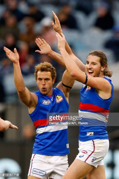 Mitch Wallis and Marcus Bontempelli of the Bulldogs celebrate a goal during the round 17 AFL match between the Carlton Blues and the Western Bulldogs...