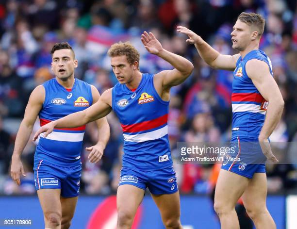 Mitch Wallis of the Bulldogs celebrates a goal with teammates during the 2017 AFL round 15 match between the Western Bulldogs and the West Coast...