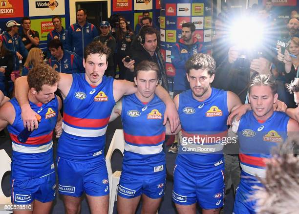 Mitch Wallis Zaine Cordy Mitch Honeychurch Tom Liberatore and Caleb Daniel of the Bulldogs sing the song in the rooms after winning the round 14 AFL...