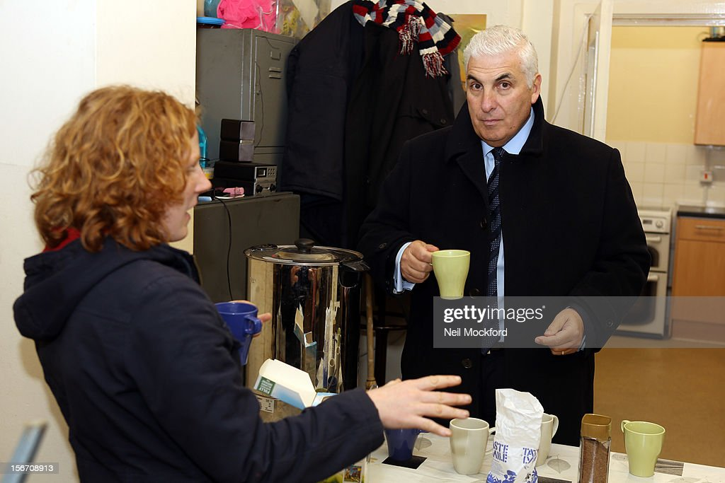 Mitch Winehouse help out making tea to show what funds raised by The Amy Winehouse Foundation are being used for at The Pillion Trust Crashpad on November 19, 2012 in London, England.