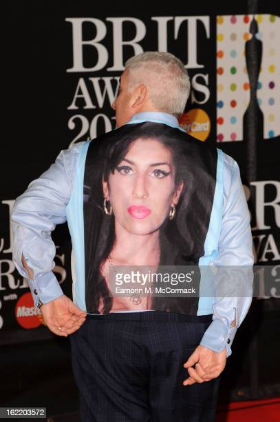 Mitch Winehouse wears a tribute to late daughter Amy Winehouse at the Brit Awards 2013 at the 02 Arena on February 20 2013 in London England