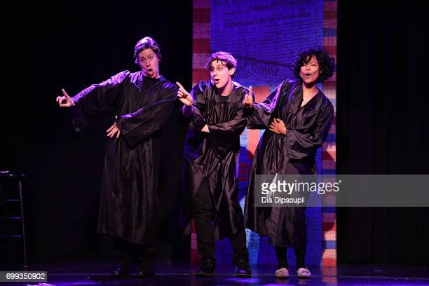 Mitchel Kawash Richard Spitaletta and Aiesha Alia Dukes perform onstage during the 'ME THE PEOPLE The Trump America Musical' Press Preview...