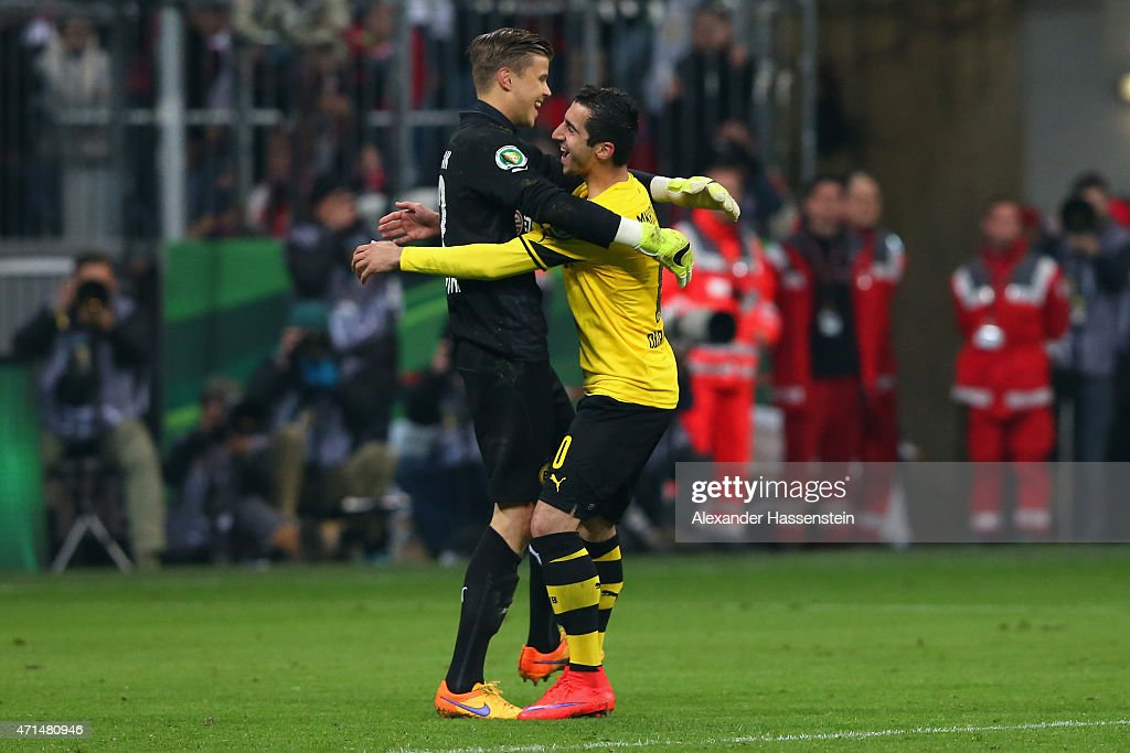 Mitchel Langerak, keeper of Dortmund celebrates with his team mate <a gi-track='captionPersonalityLinkClicked' href=/galleries/search?phrase=Henrikh+Mkhitaryan&family=editorial&specificpeople=6234732 ng-click='$event.stopPropagation()'>Henrikh Mkhitaryan</a> after the penalty shot out for the DFB Cup Semi Final match between FC Bayern Muenchen and Borussia Dortmund at Allianz Arena on April 28, 2015 in Munich, Germany.