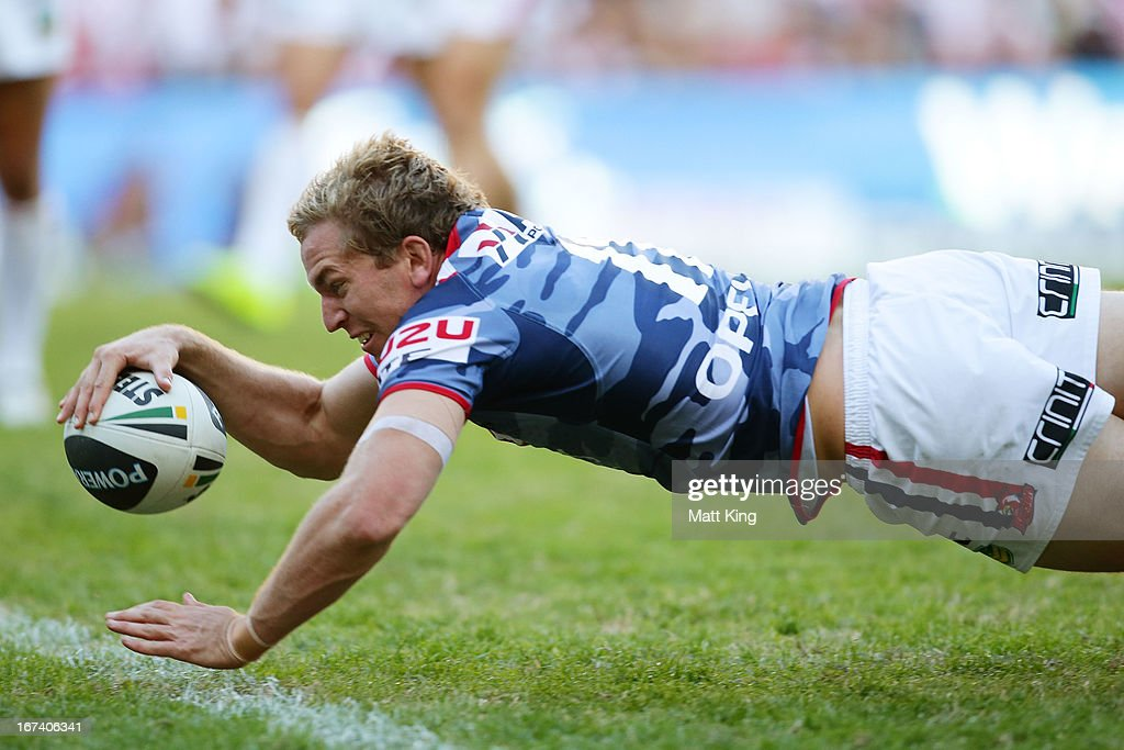 Mitchell Aubusson of the Roosters dives over to score a try during the round seven NRL match between the Sydney Roosters and the St George Illawarra Dragons at Allianz Stadium on April 25, 2013 in Sydney, Australia.