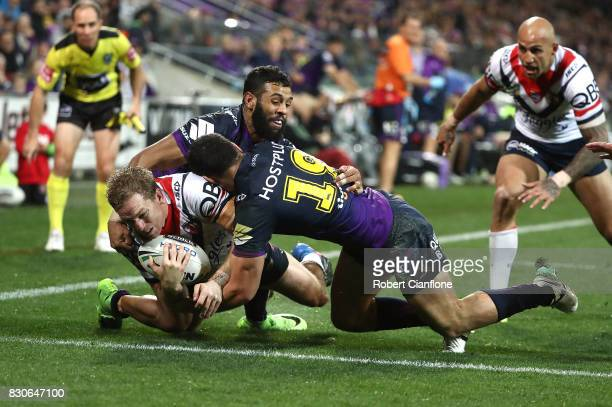 Mitchell Aubusson of the Roosters scores a try during the round 23 NRL match between the Melbourne Storm and the Sydney Roosters at AAMI Park on...