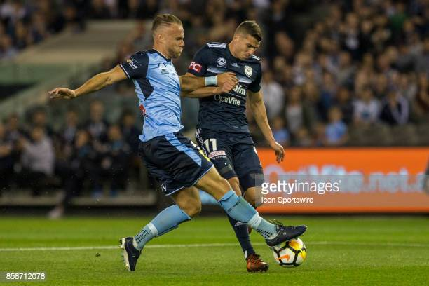 Mitchell Austin of Melbourne Victory and Jordy Buijs of Sydney FC contest the ball during Round 1 of the Hyundai ALeague Series between Sydney FC and...