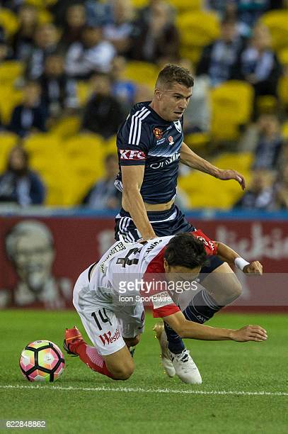 Mitchell Austin of Melbourne Victory and Jumpei Kusukami of the Western Sydney Wanderers contest the ball during the 6th round of the Hyundai ALeague...