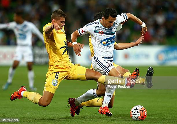 Mitchell Austin of the Central Coast and Daniel Georgievski of Victory contest the ball during the round seven ALeague match between Melbourne...