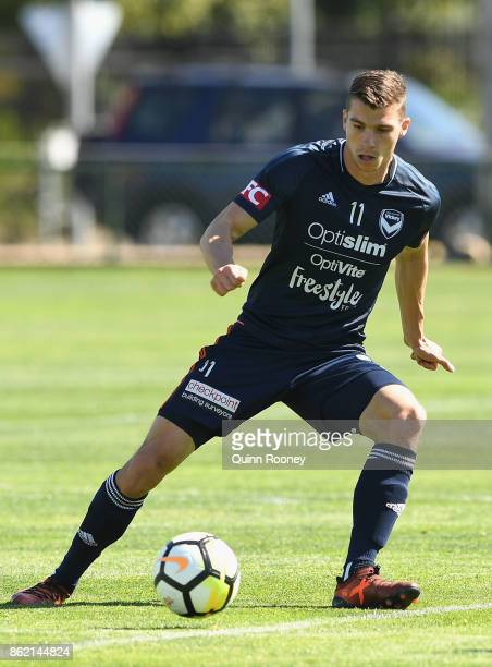 Mitchell Austin of the Victory passes the ball during a Melbourne Victory ALeague training session at Gosch's Paddock on October 17 2017 in Melbourne...