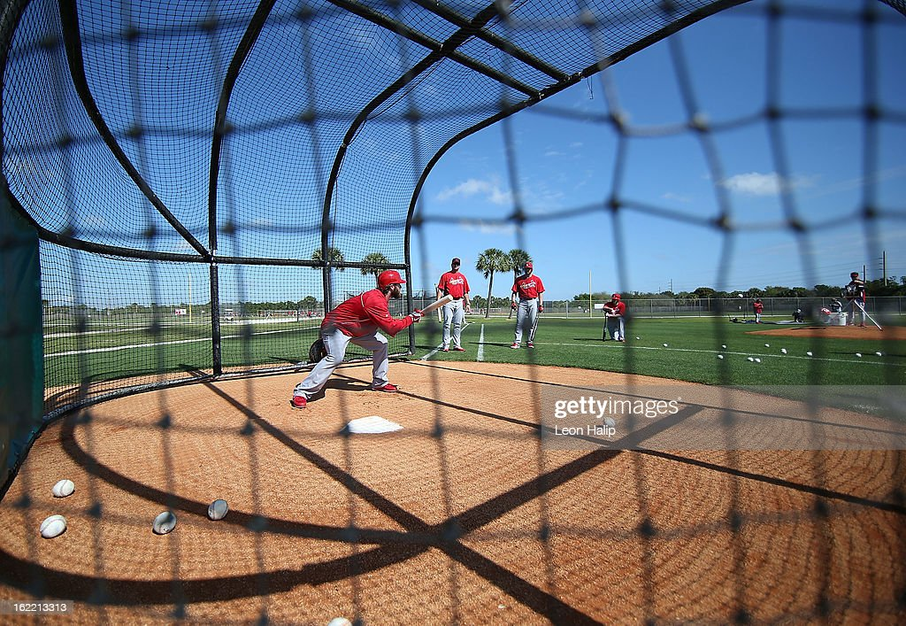 Mitchell Boggs #41 of the St. Louis Cardinals goes through the bunting drills during spring training on February 20, 2013 in Jupiter, Florida.