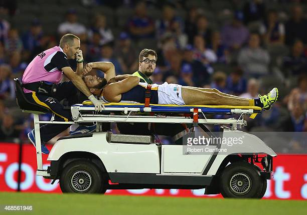 Mitchell Brown of the Eagles is taken from the ground with an injury during the round one AFL match between the Western Bulldogs and the West Coast...