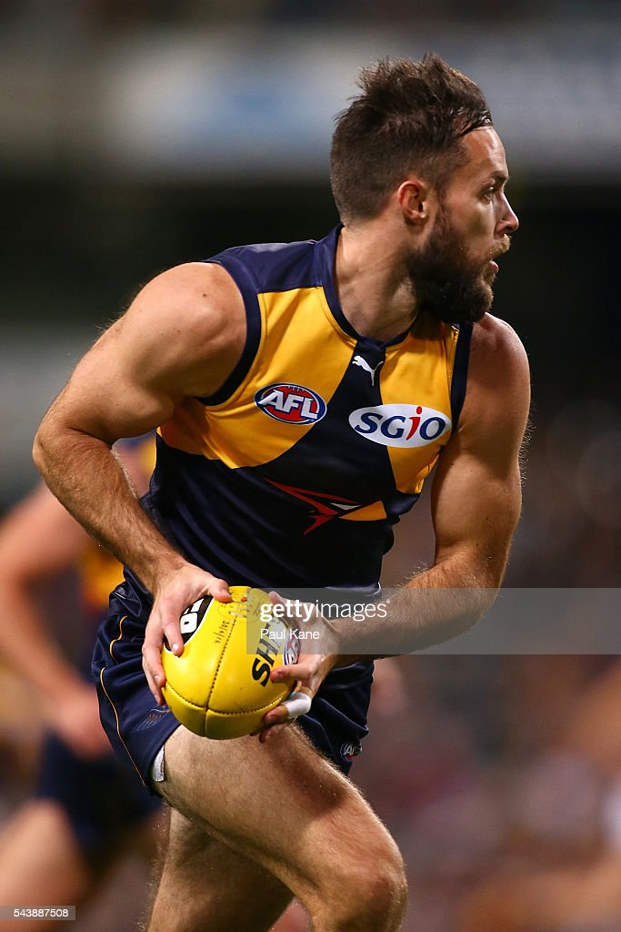 Mitchell Brown of the Eagles looks to pass the ball during the round 15 AFL match between the West Coast Eagles and the Essendon Bombers at Domain Stadium on June 30, 2016 in Perth, Australia.