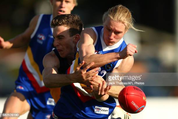 Mitchell Brown of the Eatern Ranges handballs during the round seven TAC Cup match between the Eastern Ranges and the Bendigo Pioneers at Box Hill...