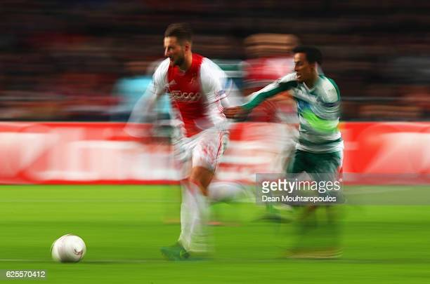 Mitchell Dijks of Ajax and Zeca of Panathinaikos chase the ball during the UEFA Europa League Group G match between AFC Ajax and Panathinaikos FC at...