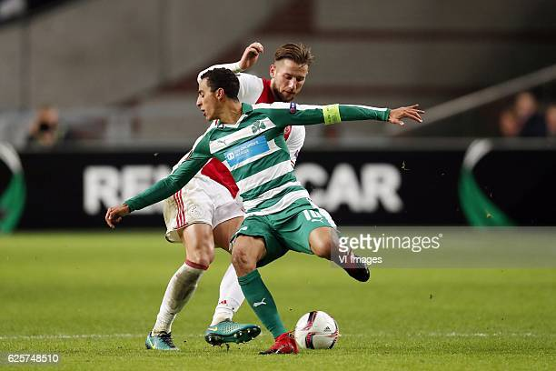 Mitchell Dijks of Ajax Zeca of Panathinaikos FCduring the UEFA Europa League group G match between Ajax Amsterdam and Panathinaikos FC at the...