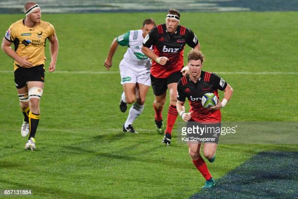 Mitchell Drummond of the Crusaders charges forward during the round five Super Rugby match between the Crusaders and the Force at AMI Stadium on...