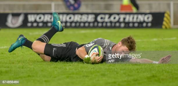 TOPSHOT Mitchell Drummond of the Crusaders scores a try during the Super XV rugby union match Cheetahs vs Crusaders at the Bloemfontein stadium on...