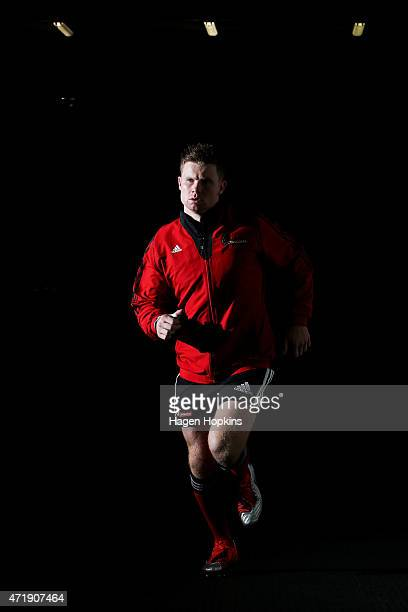 Mitchell Drummond of the Crusaders takes the field to warm up during the round 12 Super Rugby match between the Hurricanes and the Crusaders at...