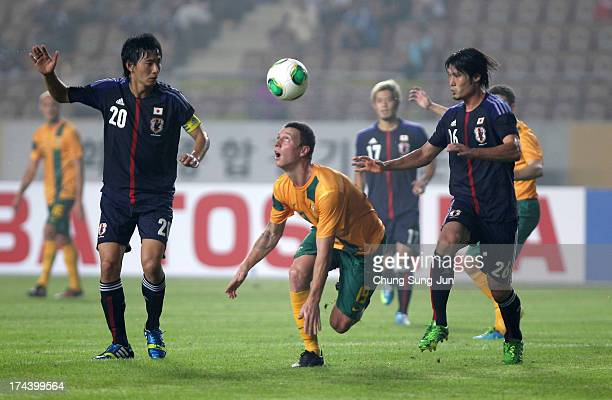Mitchell Duke of Japan competes for the ball with Hideto Takahashi and Daisuke Suzuki of Japan during the EAFF East Asian Cup match between Japan and...