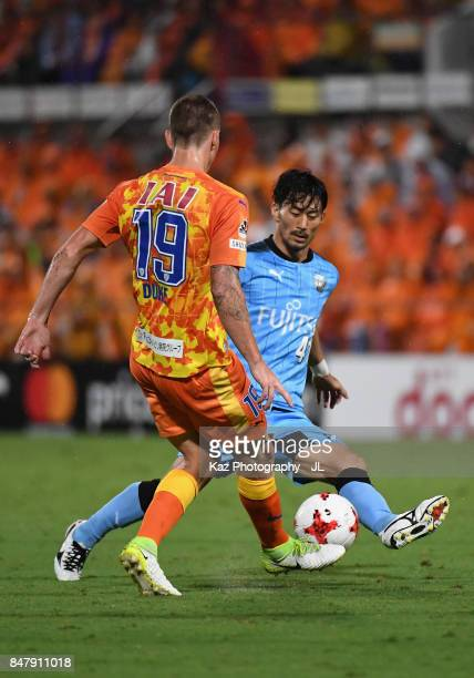 Mitchell Duke of Shimizu SPulse and Akihiro Ienaga of Kawasaki Frontale compete for the ball during the JLeague J1 match between Shimizu SPulse and...