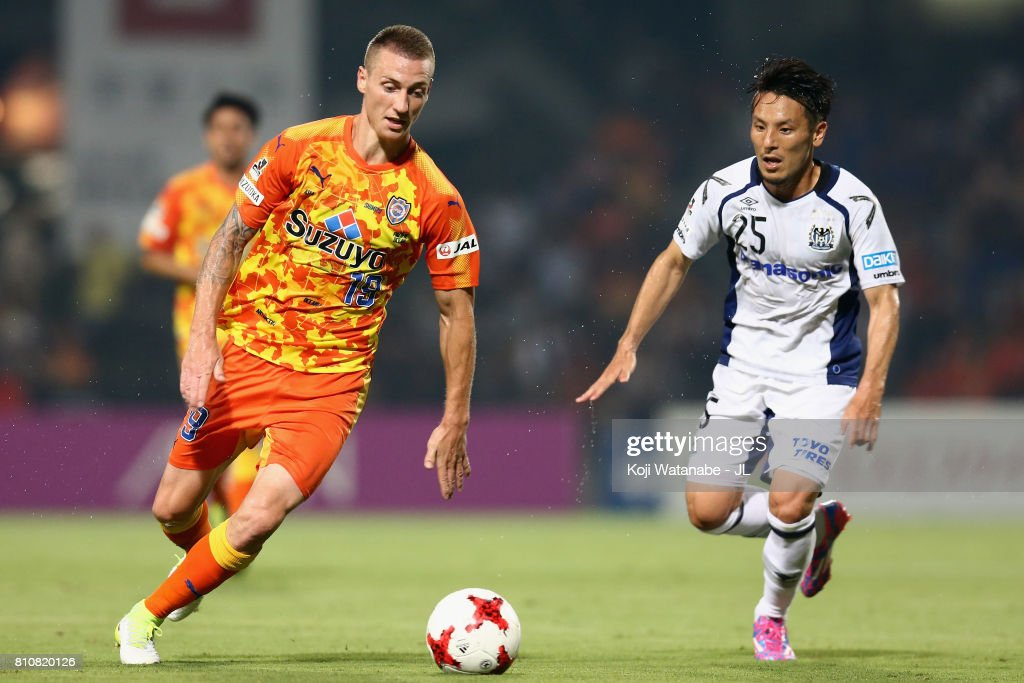 Mitchell Duke of Shimizu S-Pulse and Jungo Fujimoto of Gamba Osaka compete for the ball during the J.League J1 match between Shimizu S-Pulse and Gamba Osaka at IAI Stadium Nihondaira on July 8, 2017 in Shizuoka, Japan.