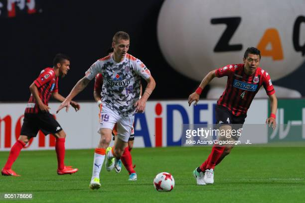 Mitchell Duke of Shimizu SPulse and Ryuji Kawai of Consadole Sapporo compete for the ball during the JLeague J1 match between Consadole Sapporo and...