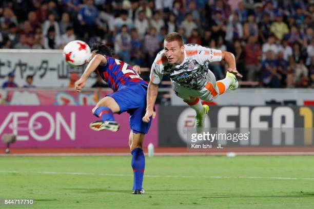 Mitchell Duke of Shimizu SPulse and Shohei Abe of Ventforet Kofu compete for the ball during the JLeague J1 match between Ventforet Kofu and Shimizu...