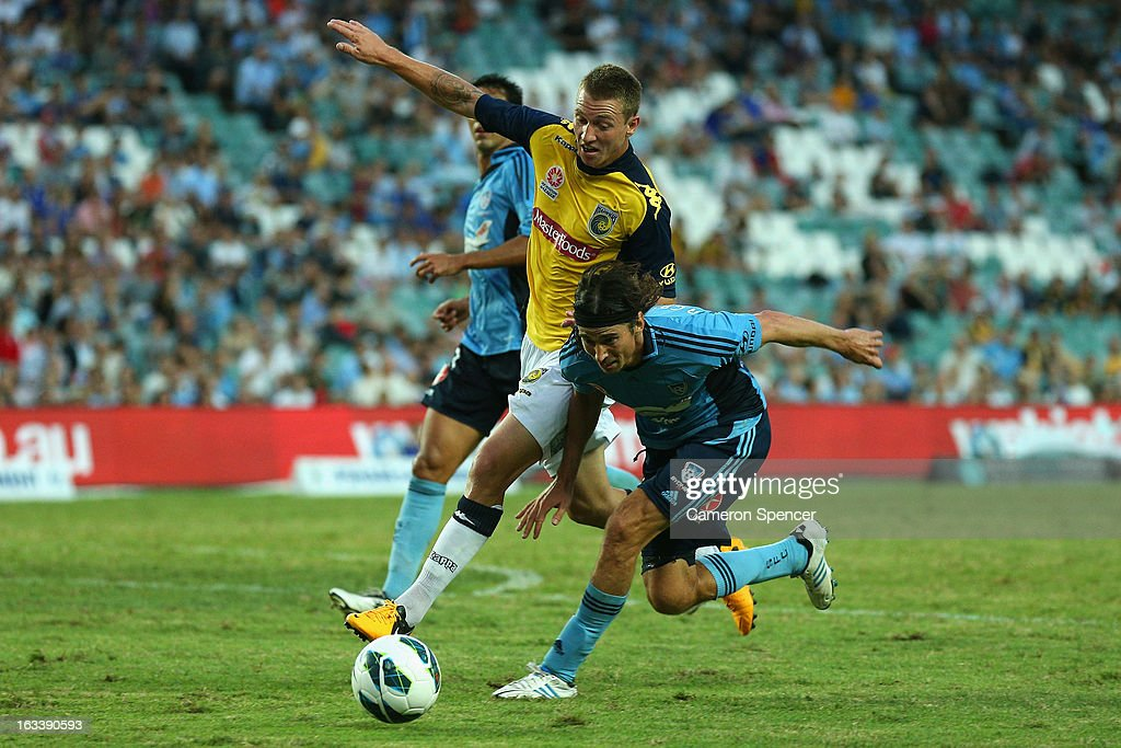 Mitchell Duke of the Mariners and Adam Griffiths of Sydney FC contest the ball during the round 24 A-League match between Sydney FC and the Central Coast Mariners at Allianz Stadium on March 9, 2013 in Sydney, Australia.