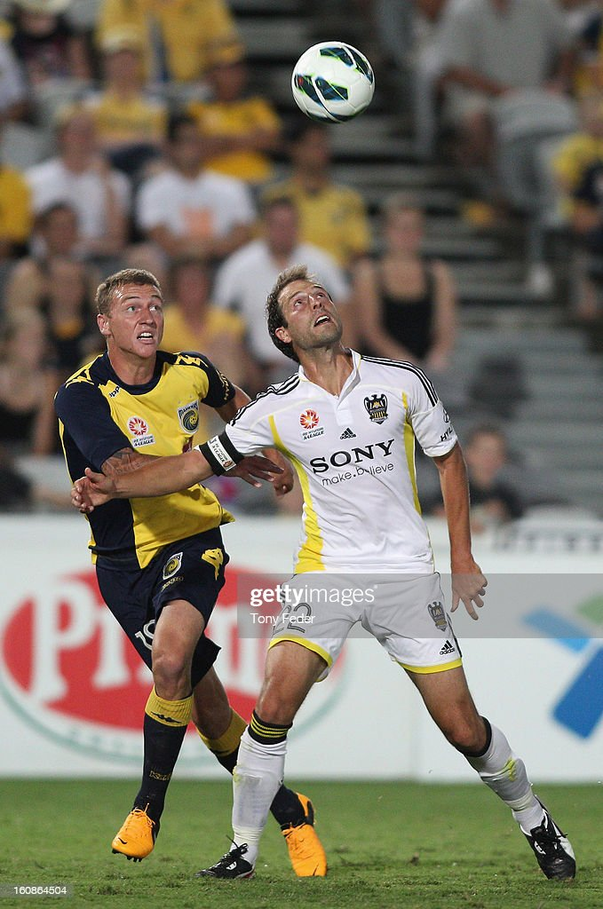 Mitchell Duke of the Mariners and Daniel Sanchez of the Phoenix contest the ball during the round 20 A-League match between the Central Coast Mariners and the Wellington Phoenix at Bluetongue Stadium on February 7, 2013 in Gosford, Australia.