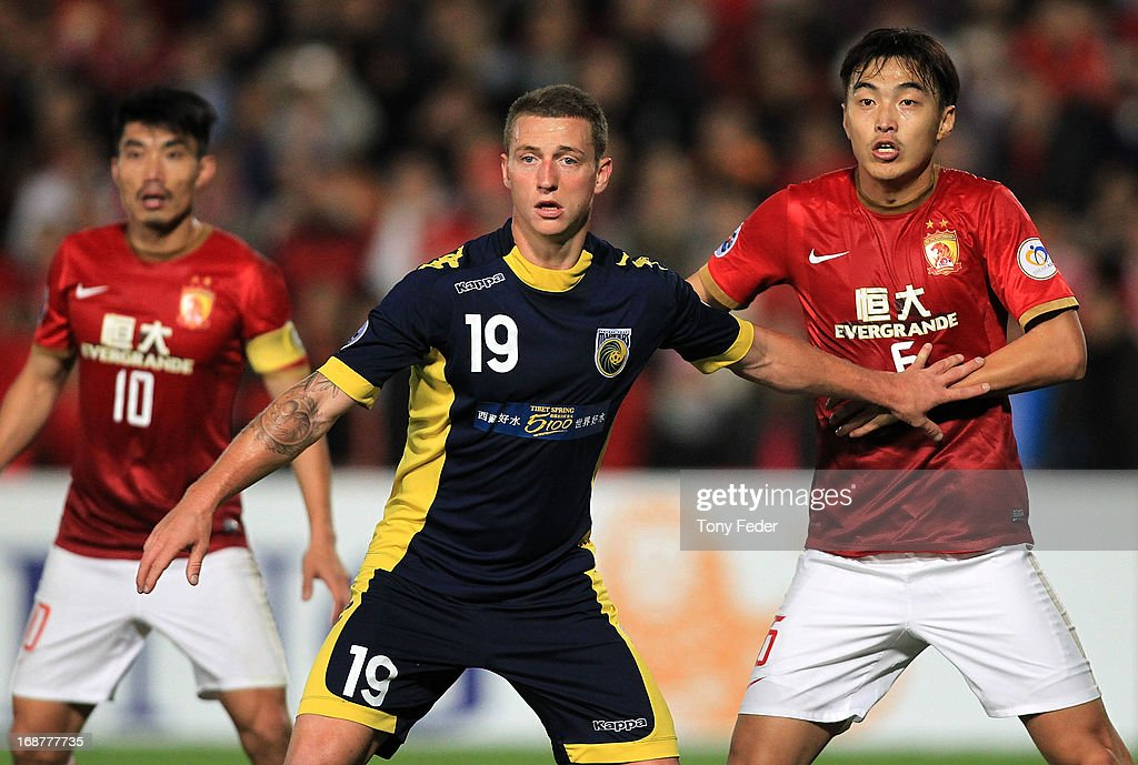 Mitchell Duke of the Mariners and Feng Xiaoting of Evergrande jostle in the penalty area during the AFC Asian Champions League match between the Central Coast Mariners and Guangzhou Evergrande at Bluetongue Stadium on May 15, 2013 in Gosford, Australia.