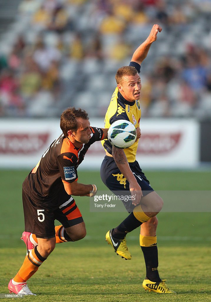 Mitchell Duke of the Mariners and Ivan Franjic of the Brisbane Roar contest the ball during the round eight A-League match between the Central Coast Mariners and the Brisbane Roar at at Bluetongue Stadium on November 25, 2012 in Gosford, Australia.