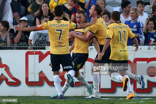 Mitchell Duke of the Mariners celebrates with team mates after scoring a goal during the round one ALeague match between the Central Coast Mariners...