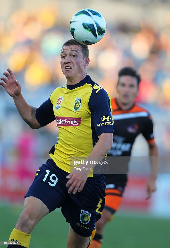 Mitchell Duke of the Mariners heads the ball during the round 25 A-League match between the Central Coast Mariners and the Brisbane Roar at Bluetongue Stadium on March 17, 2013 in Gosford, Australia.