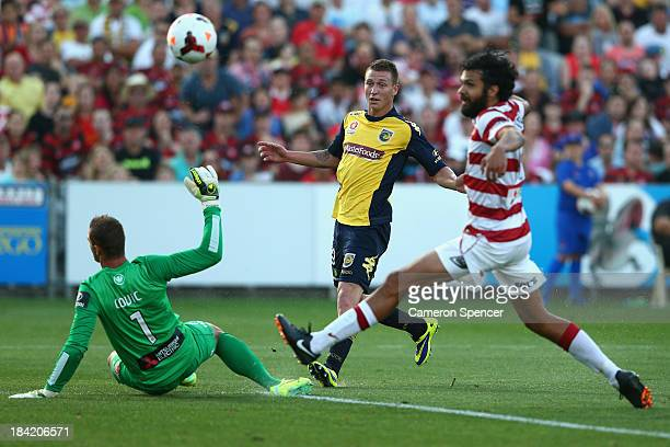 Mitchell Duke of the Mariners kicks a goal during the round one ALeague match between the Central Coast Mariners and the Western Sydney Wanderers at...