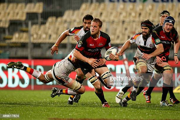 Mitchell Dunshea of Canterbury looks to offload the ball during the round seven ITM Cup match between Canterbury and Waikato at AMI Stadium on...