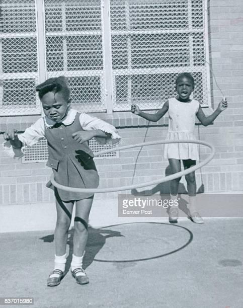 Mitchell Elementary School Watching Jamey Hawkins in hula hoop is Nanette Dawson who prefers skipping rope herself Credit Denver Post