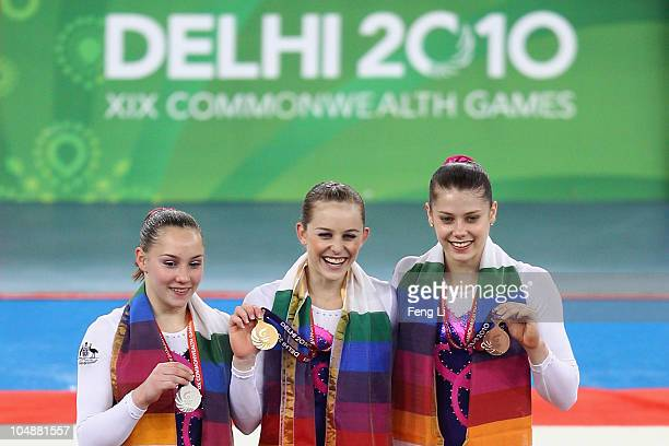 L Mitchell Emily Little and Georgia Bonora of Australia celebrate at the medal ceremony for the Women's Artistic Gymnastics Individual AllAround...