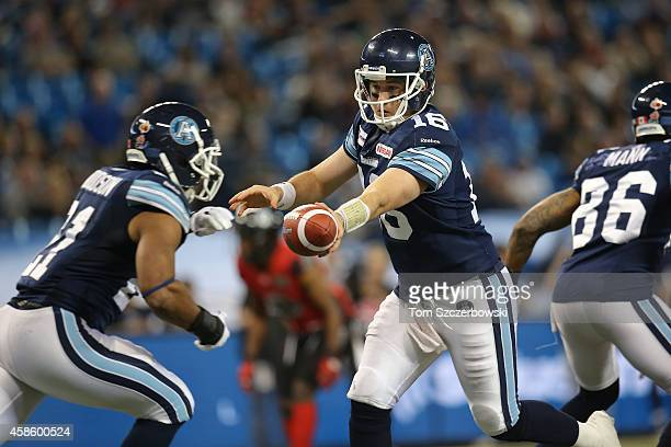 Mitchell Gale of the Toronto Argonauts hands the ball off to Anthony Woodson during CFL game action against the Ottawa Redblacks on November 7 2014...