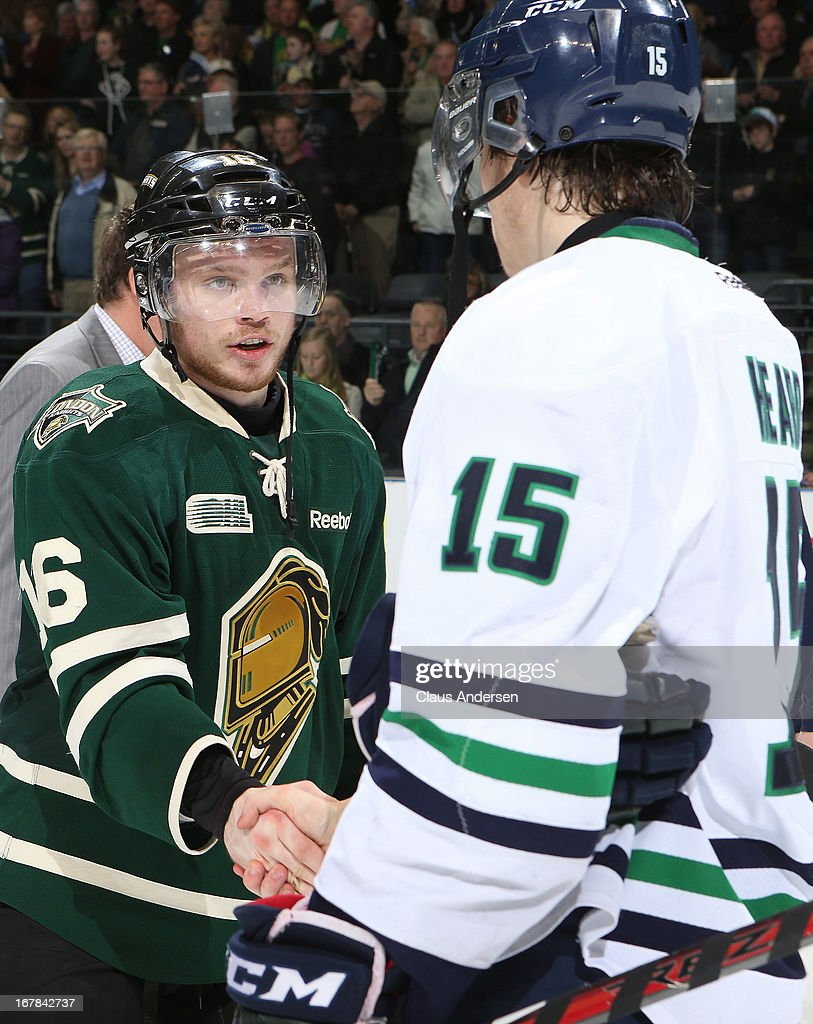 Mitchell Heard #15 of the Plymouth Whalers congratulates Max Domi #16 of the London Knights after the Knights win in Game Five of the Western Conference Final on April 26, 2013 at the Budweiser Gardens in London, Ontario, Canada. The Knights defeated the Whalers 5-4 in overtime to win the series 4-1.