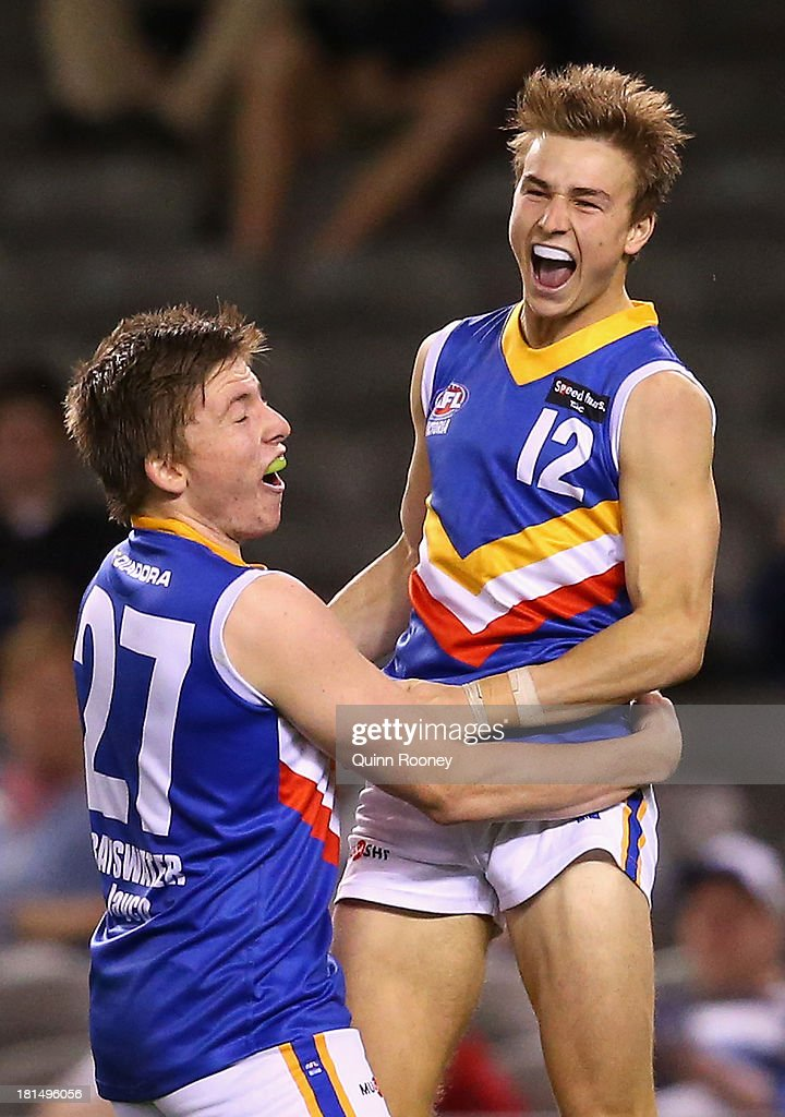 Mitchell Honeychurch of the Ranges is congratulated by Jacob Crowe after kicking a goal during the TAC Cup final match between Eastern Ranges and the Dandenong Southern Stingrays at Etihad Stadium on September 22, 2013 in Melbourne, Australia.