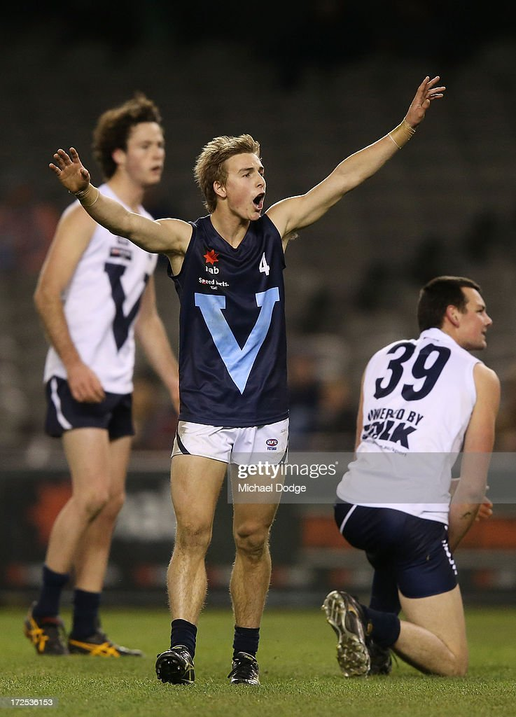 Mitchell Honeychurch of Vic Metro celebrates a goal during the AFL Under 18s Championship match between Victoria Country and Victoria Metro at Etihad Stadium on July 3, 2013 in Melbourne, Australia.