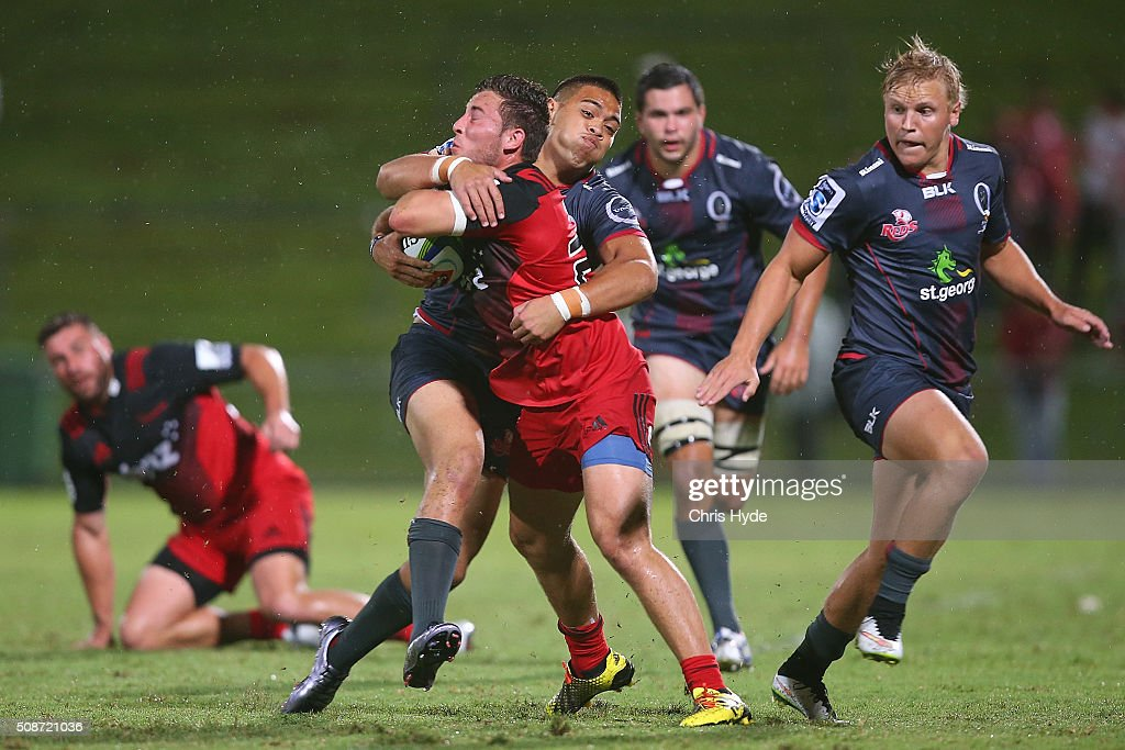 Mitchell Hunt of the Crusaders is tackled during the Super Rugby pre-season match between the Reds and the Crusaders at Ballymore Stadium on February 6, 2016 in Brisbane, Australia.