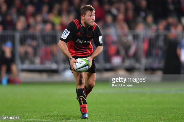 Mitchell Hunt of the Crusaders looks to pass the ball during the round five Super Rugby match between the Crusaders and the Force at AMI Stadium on...
