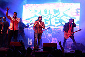 Mitchell Jarvis and The 'Rock Of Ages' Broadway cast perform live on stage during the 'Rock Of Ages' Broadway cast reunion concert at Highline...