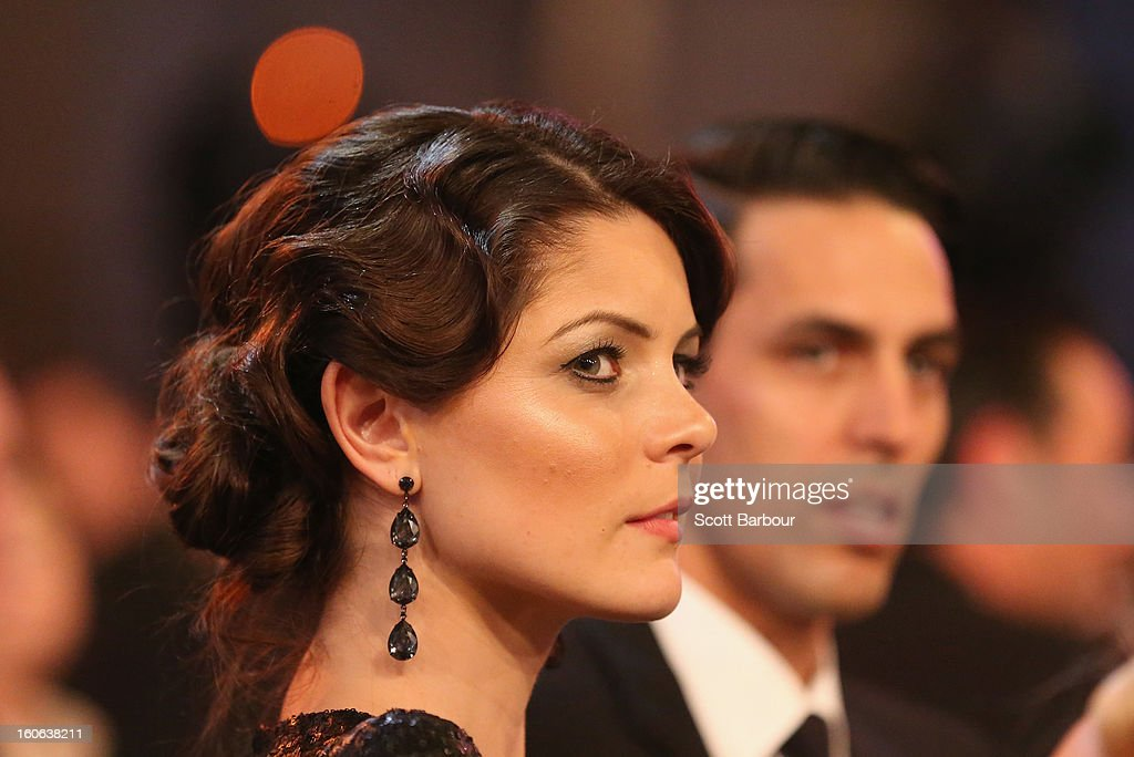 Mitchell Johnson and Jessica Johnson look on during the 2013 Allan Border Medal awards ceremony at Crown Palladium on February 4, 2013 in Melbourne, Australia.
