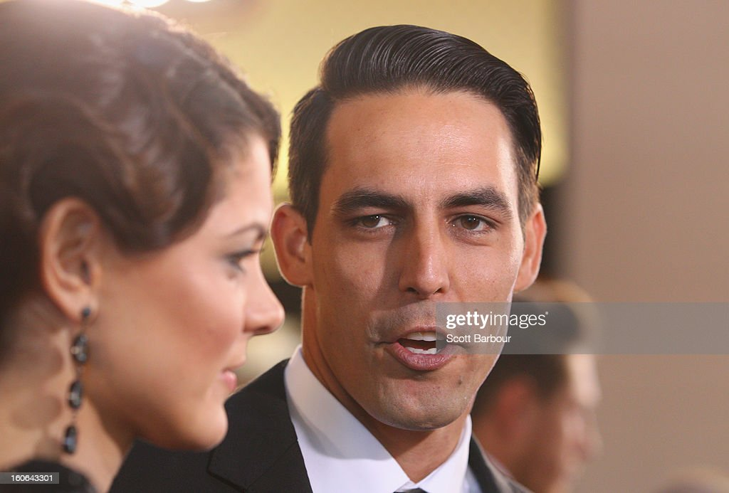 Mitchell Johnson and Jessica Johnson speak to the media during the 2013 Allan Border Medal awards ceremony at Crown Palladium on February 4, 2013 in Melbourne, Australia.
